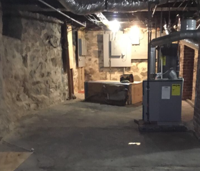 Cleaned, dried basement with furnace and ductwork showing