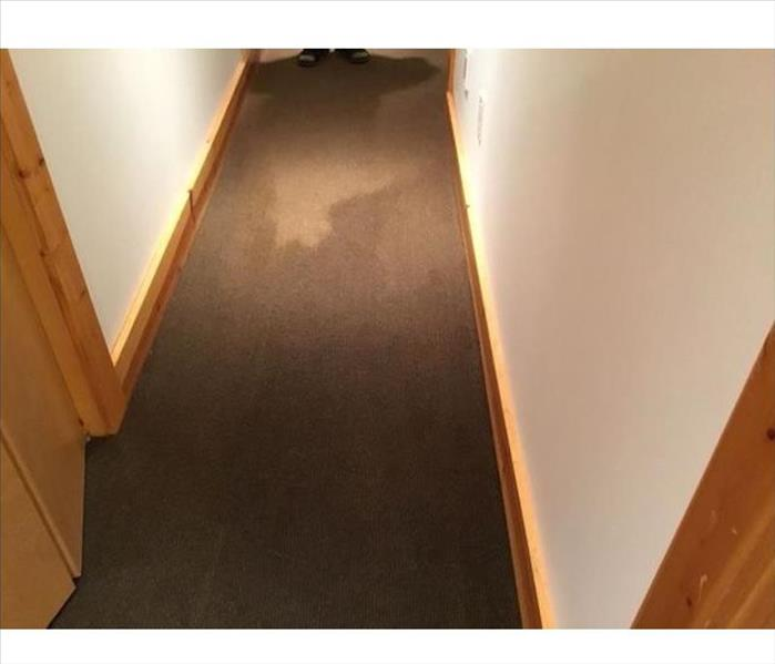 Hallway with wet carpet