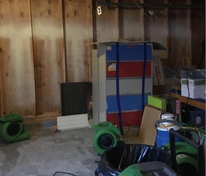 Garage with framework showing and items in the middle of the floor