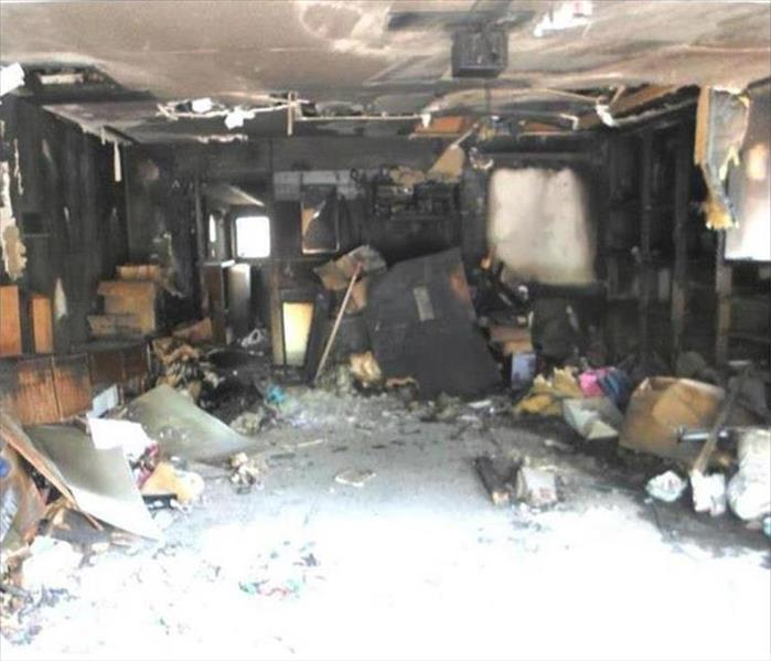 badly burned and charred garage interior