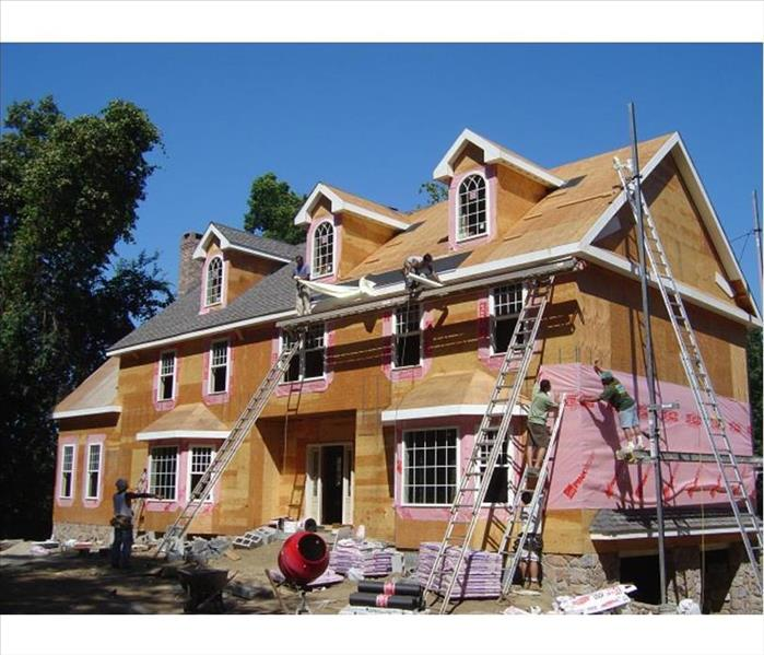 workers sheathing and replacing a roof in waterbury