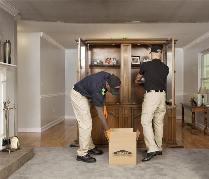SERVPRO techs packing away contents of home